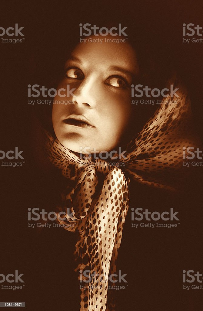 Sepia Toned Portrait of Young Woman Wearing Scarf stock photo