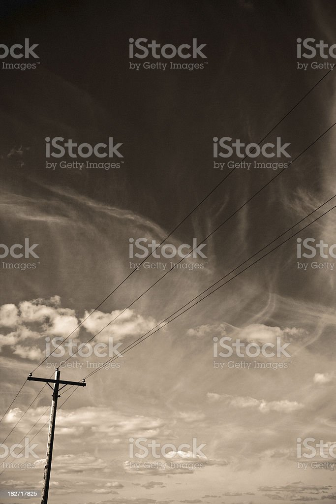 Sepia Toned Telephone Pole And Dramatic Sky royalty-free stock photo