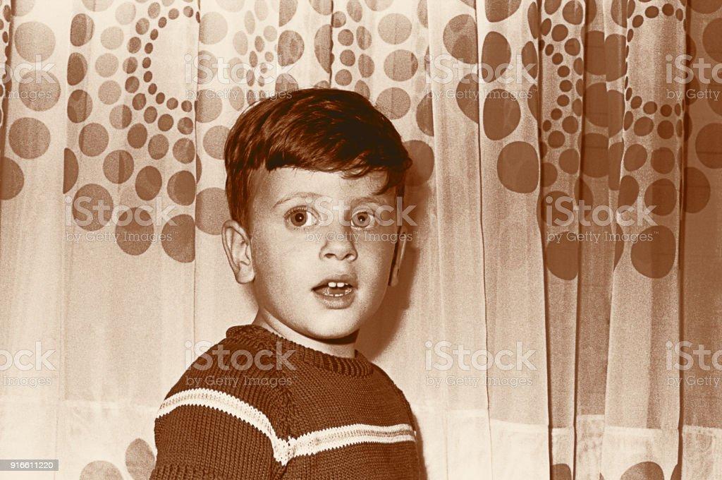 Sepia toned vintage boy stock photo