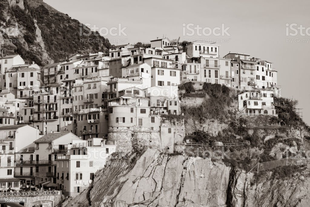 sepia-toned-vintage-effect-hillside-village-buildings-built-on-rock-picture-id1036244018