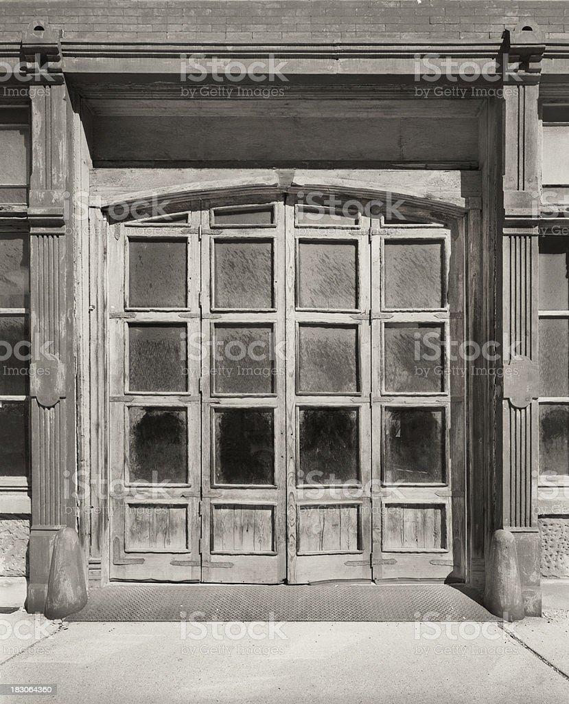 Charming Sepia Toned Vintage Garage Door Royalty Free Stock Photo