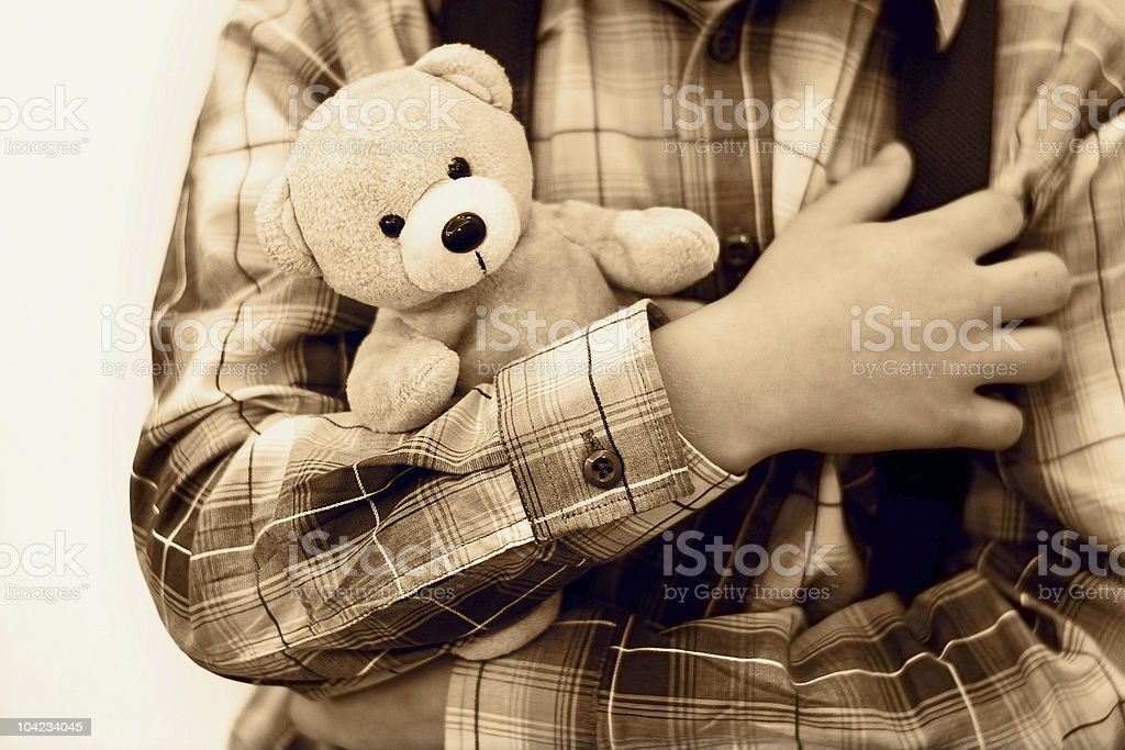Safety concept. The boy is holding little teddy bear