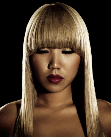 sepiatoned portrait of asian woman with long blonde hair