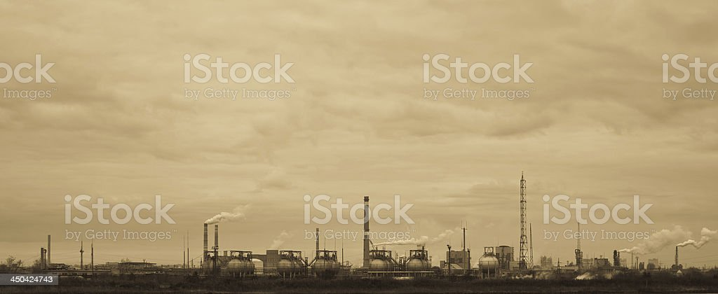 Sepia-toned view of old chemical factory royalty-free stock photo