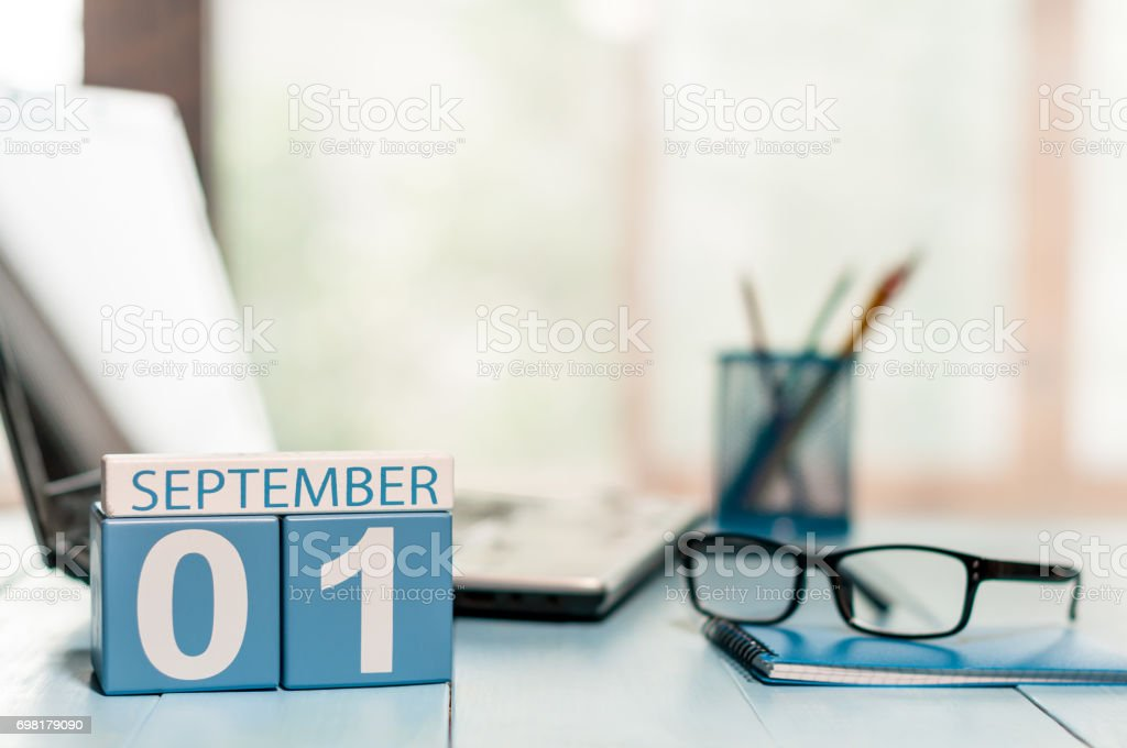 September 1st. Day 1 of month, Back to school concept. Calendar on teacher or student workplace background. Autumn time. Empty space for text stock photo