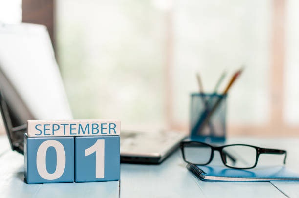 september 1st. day 1 of month, back to school concept. calendar on teacher or student workplace background. autumn time. empty space for text - september stock photos and pictures