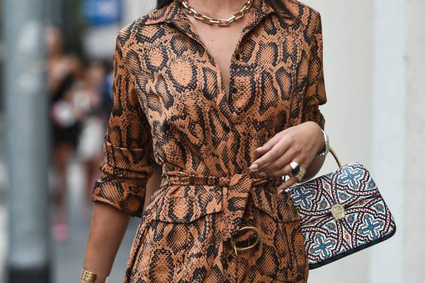 September 21, 2018: Milan, Italy - Street style outfits in detail during Milan Fashion Week  - MFWSS19 September 21, 2018: Milan, Italy - Street style outfits in detail during Milan Fashion Week  - MFWSS19 fashion stock pictures, royalty-free photos & images