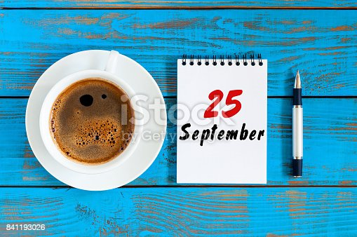 istock September 25th. Day 25 of month, loose-leaf calendar and cappuccino cup at Administrator workplace background. Autumn time. Empty space for text 841193026