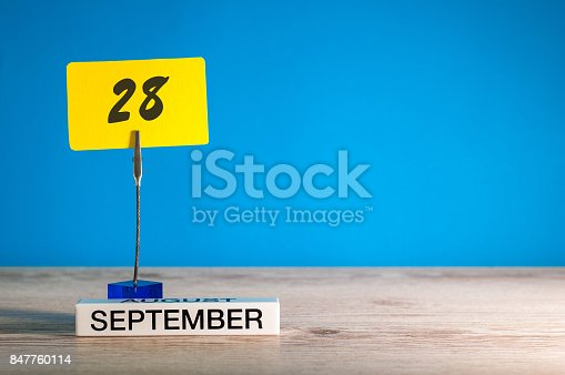 istock September 28th. Day 28 of month, Calendar on teacher or student, pupil table with empty space for text, copy space 847760114
