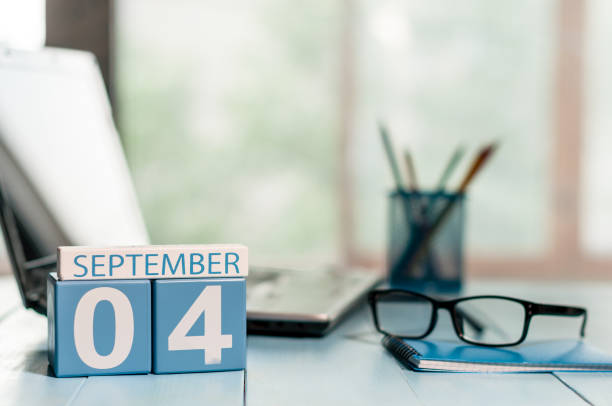 September 4th. Day 4 of month, wooden color calendar on student workplace background. Autumn time September 4th. Day 4 of month, wooden color calendar on student workplace background. Autumn time. day 4 stock pictures, royalty-free photos & images
