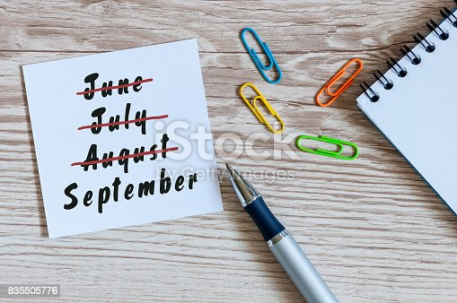 istock September beginning and summer end concept written at notepad on workplace background. Striked June, July, August 835505776