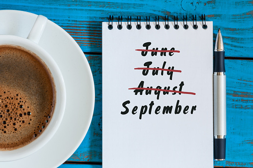 istock September beginning and summer end concept written at notepad with 594474044