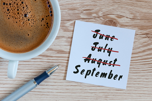 istock September beginning and summer end concept written at notepad with morning cup of coffee. Striked June, July, August 826574194