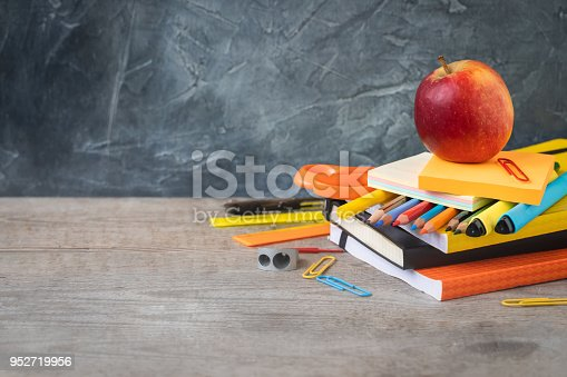 istock 1 September concept postcard, back to school or college, an apple on supplies 952719956