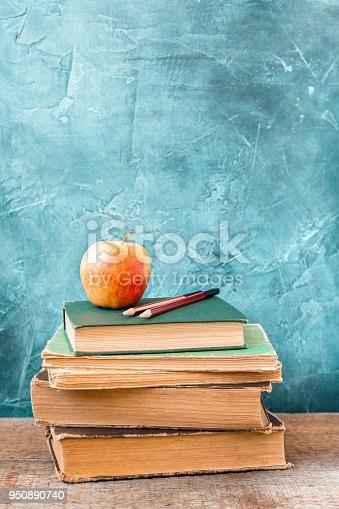 istock 1 September concept postcard, teachers' day, back to school or college, stack of vintage books, fresh apple 950890740