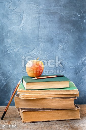 istock 1 September concept postcard, teachers' day, back to school or college, stack of vintage books, fresh apple 951431250