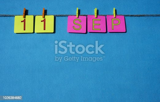 istock September, copy space with rope colored papers calendar 1026384682