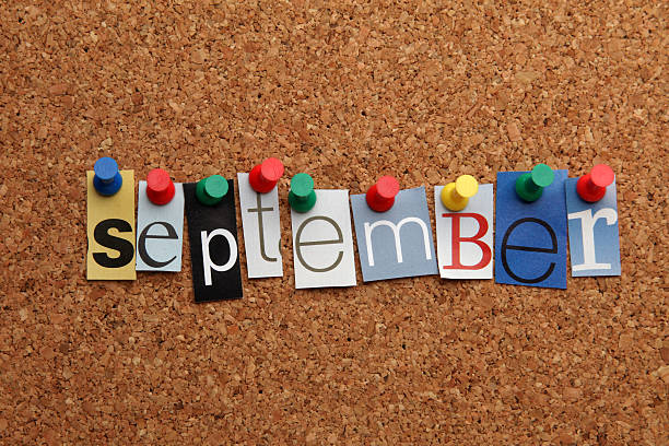 september pinned on noticeboard - september stock photos and pictures