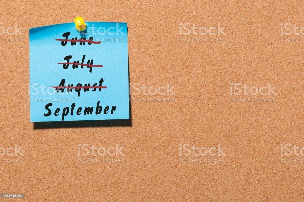 September start and summer end concept written on sticker pinned on...