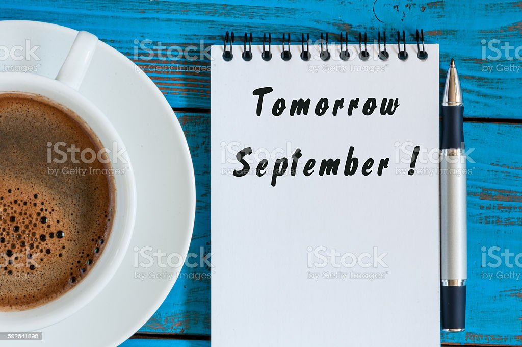 September tomorrow word wrote on white notepad at blue wood – Foto