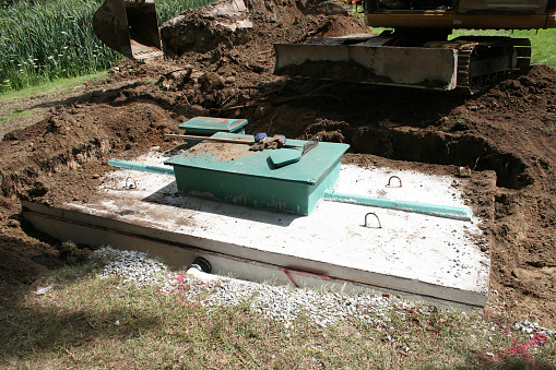 Septic system construction with concrete wastewater reservoir.