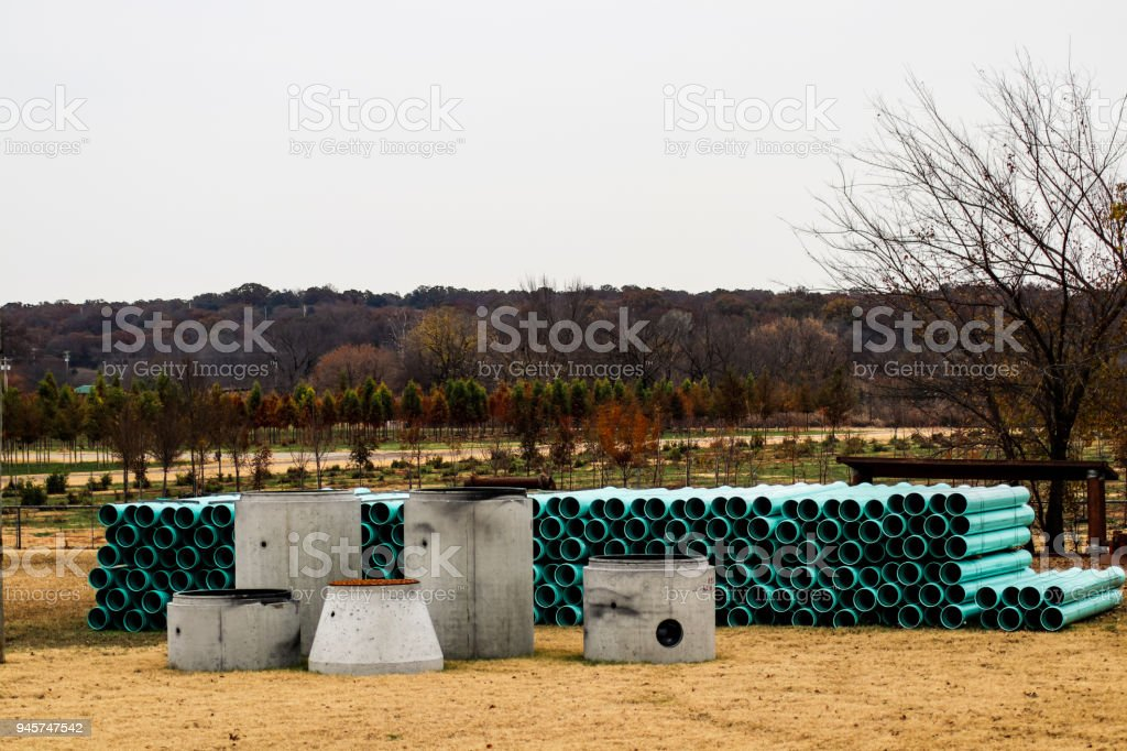 Septic tank components sitting outside - on display stock photo