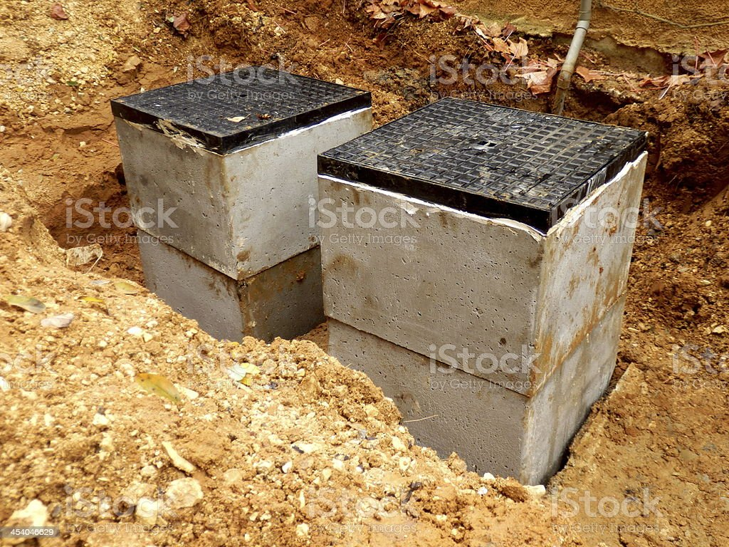 Septic tank inspection hatches stock photo