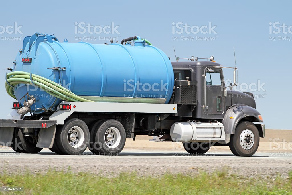 Septic Tank Pump Truck On Highway, Side View stock photo