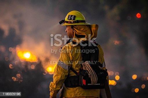 William Riley looks down to the brush fire at Sepulveda Basin on Thursday, Oct. 24, 2019, in Los Angeles, Calif. The fire started out earlier in the afternoon and has caused to burn 50 acres of land.(Photo by Kevin Lendio)