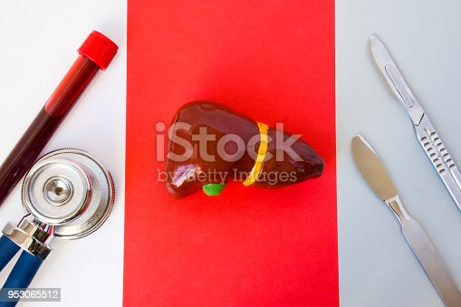 istock Sequence of medical items: stethoscope and laboratory test tube with blood sample, anatomical model of liver, two surgical scalpel on white, red and gray background. Diagnosis and treatment of liver 953065512