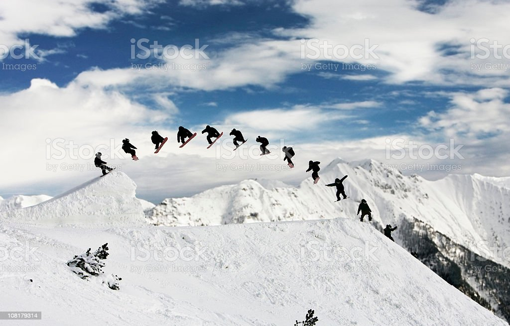 Sequence Shot of Snowboarder Jumping in Mountain Park stock photo