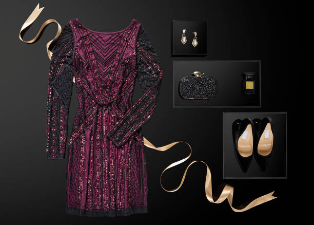 Sequin dress with personal accessories isolated on black background Sequin dress with personal accessories isolated on black background ( with clipping path) evening wear stock pictures, royalty-free photos & images