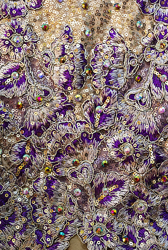 Sequins pattern white and purple on the textile background
