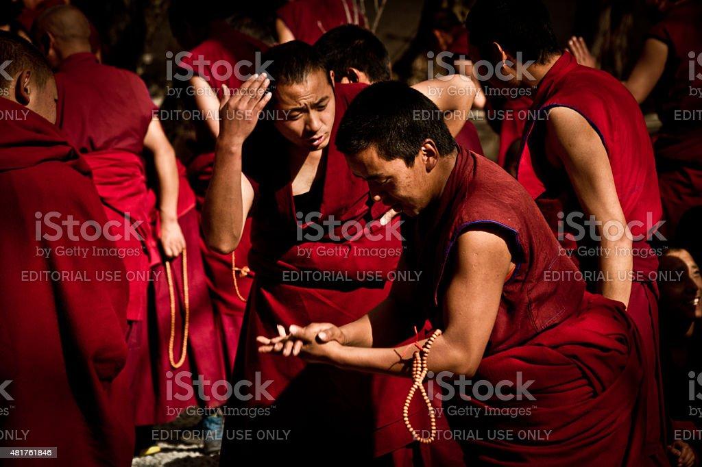 Sera Monastery Debating Monks debate Buddhist principles in Lhasa Tibet stock photo