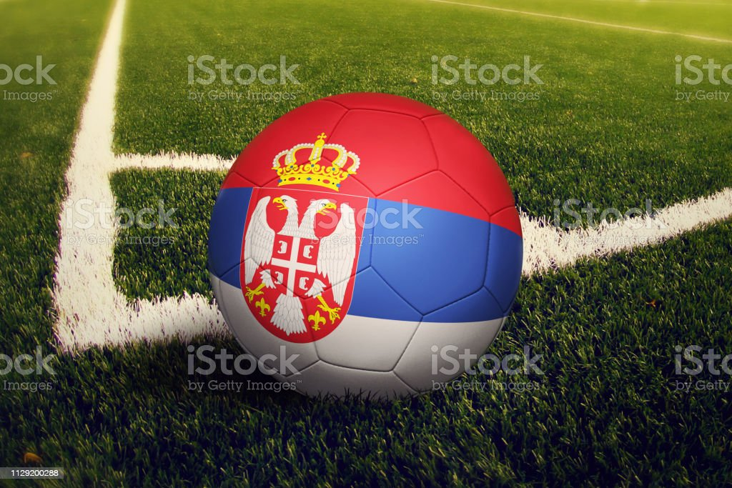 Serbia ball on corner kick position, soccer field background. National football theme on green grass. - fotografia de stock