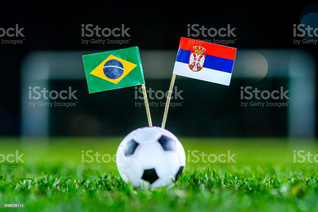 Serbia - Brazil, Group E, Wednesday, 27. June, Football, World Cup, Russia 2018, National Flags on green grass, white football ball on ground. stock photo