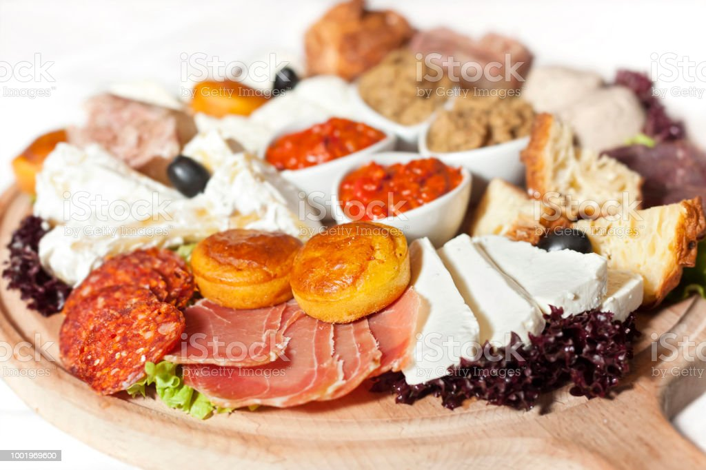 Serbian cheese and meat appetizer plate stock photo