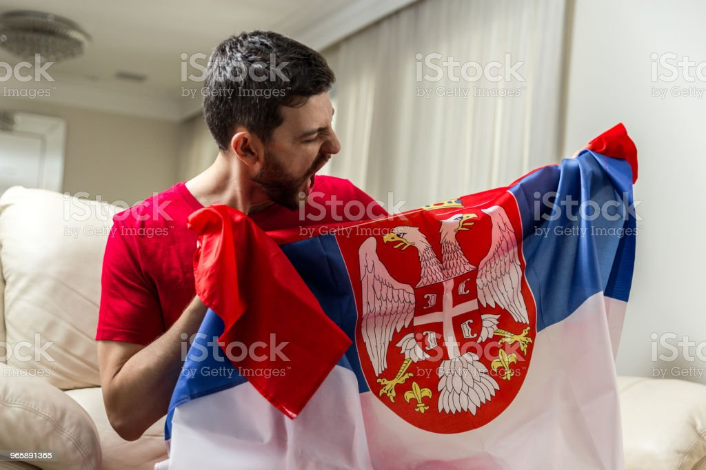Serbian fan celebrating at home - Royalty-free Adult Stock Photo