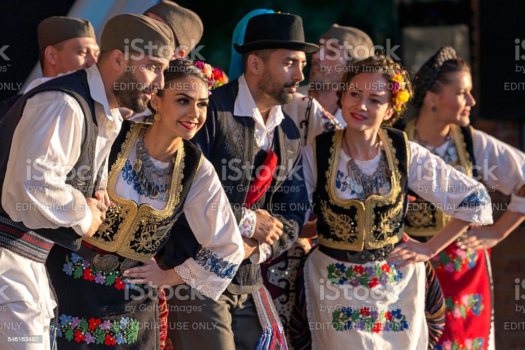 Serbian folk dancers perform in a show stock photo