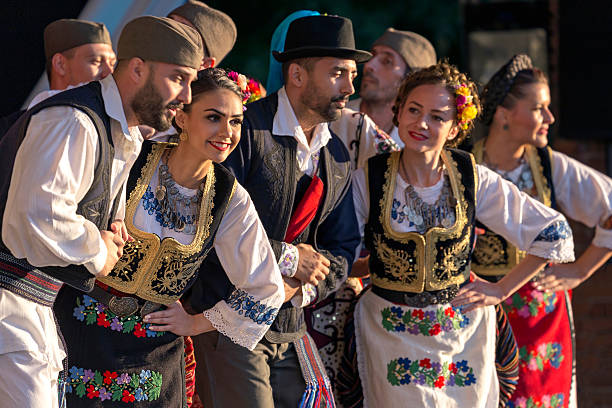 serbian folk dancers perform in a show - serbia stock photos and pictures