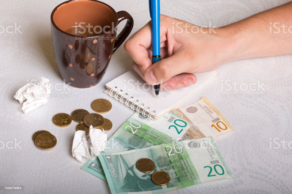 Serbian money, cup of coffee and hand stock photo