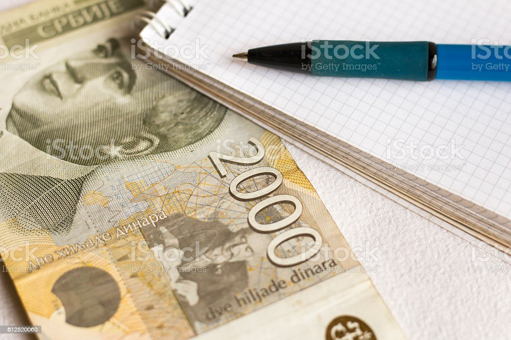 Serbian paper money, note pad and pen stock photo