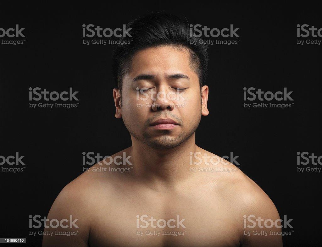 Serene asian man stock photo