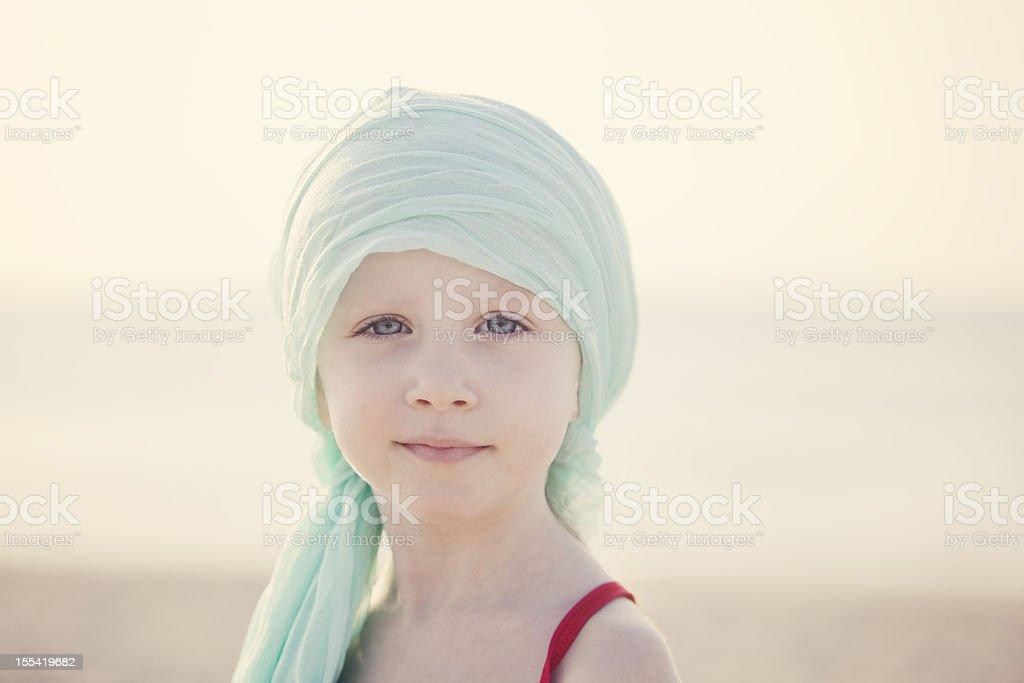 Serene Chemo Child At Beach stock photo