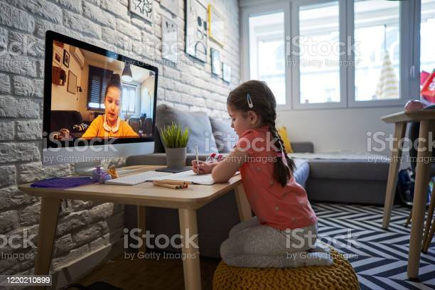 Serene Children Drawing Together Over A Video Call During A Covid19 Outbreak Stock Photo - Download Image Now