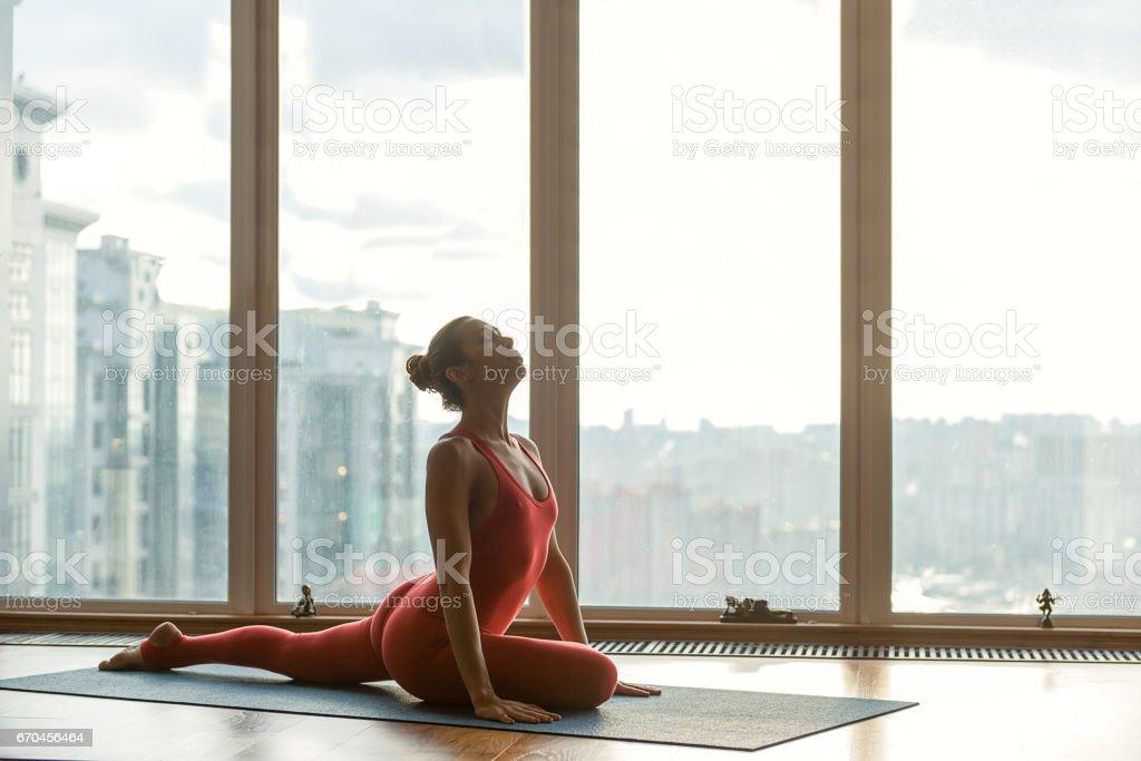 Serene female athlete sitting on string stock photo