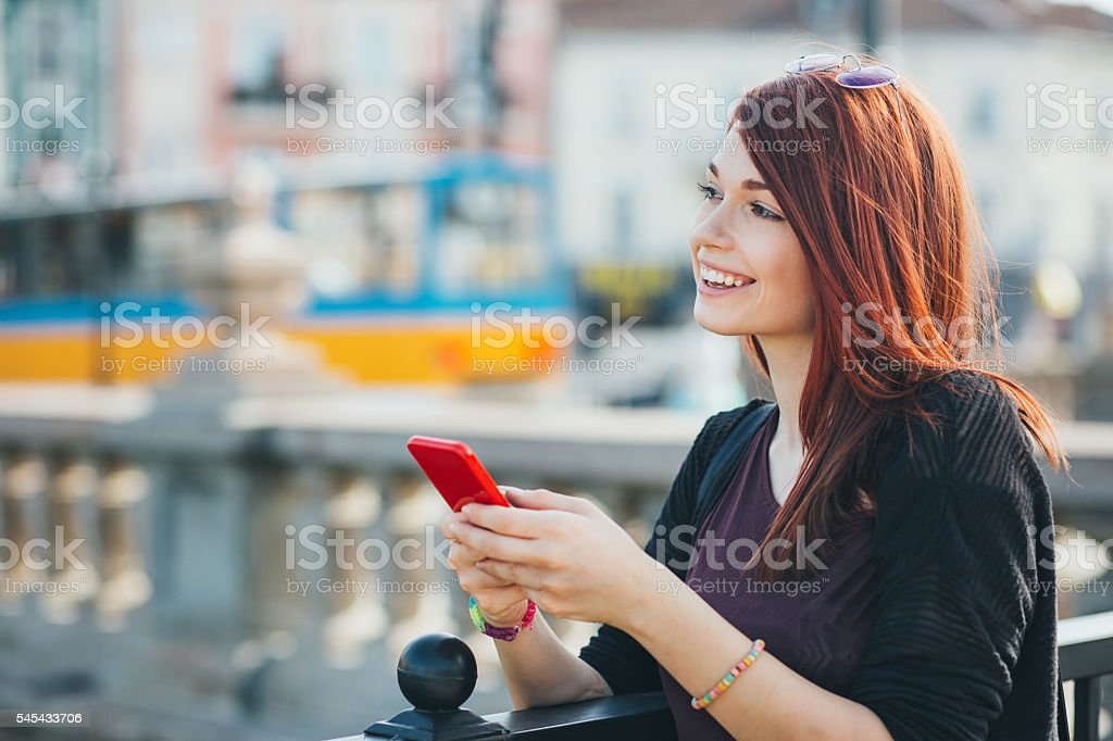 Serene girl with smart phone stock photo