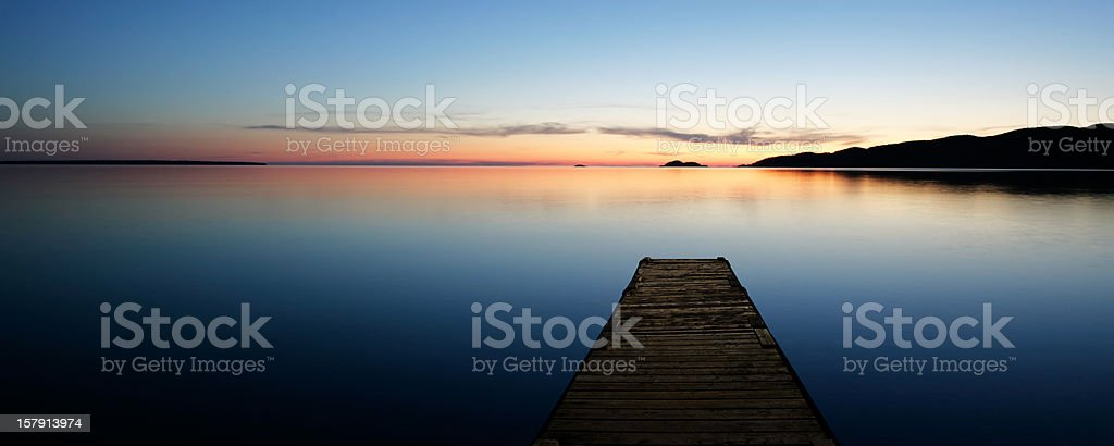 XL serene lake with dock stock photo