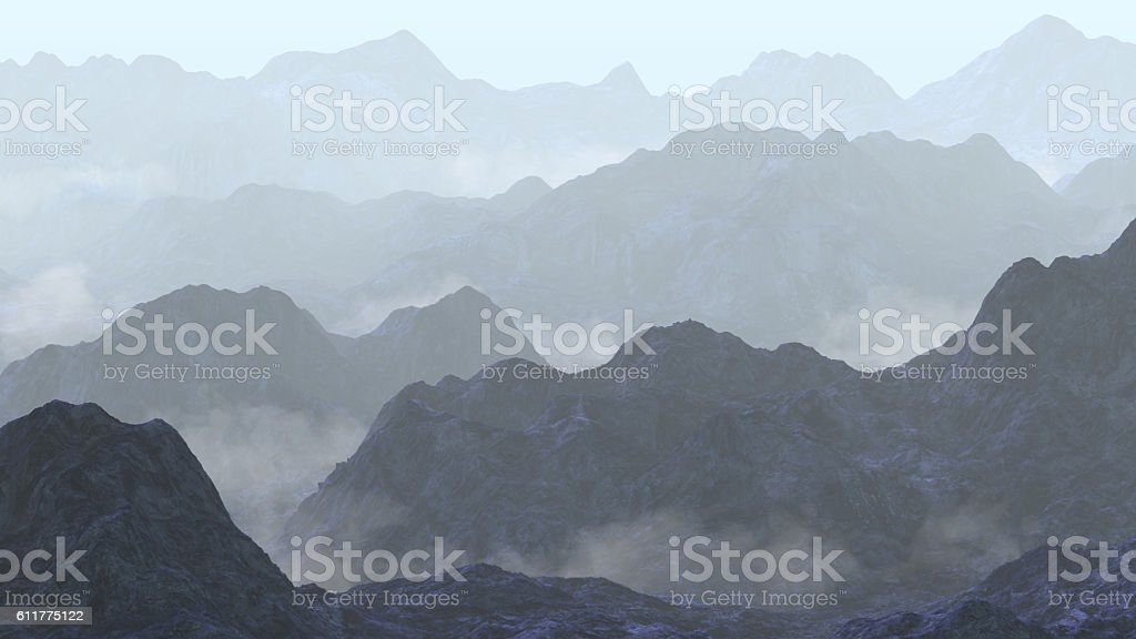 serene landscape with low crawling fog in the mountains stock photo