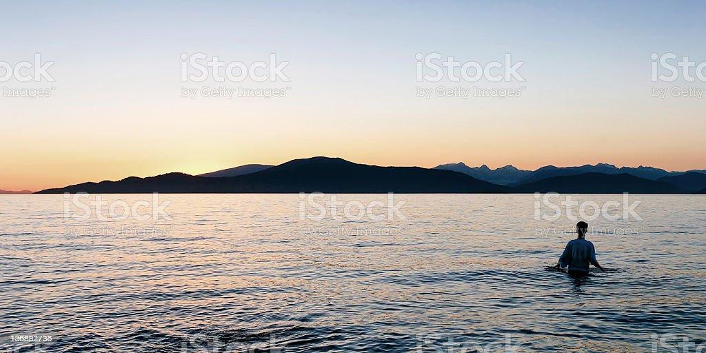 serene man silhouette stock photo